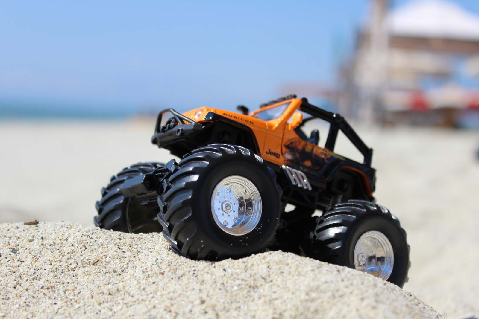 Jeep toy on sand