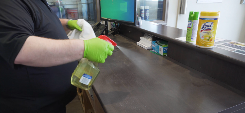 Cleaning of the front counter in an auto glass shop